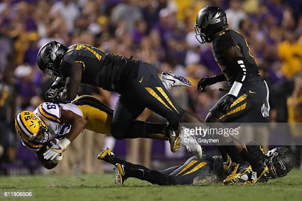 Travin Dural of the LSU Tigers is tackled by Terry Beckner Jr. #79 of the Missouri Tigers at Tiger Stadium on October 1, 2016 in Baton Rouge,...