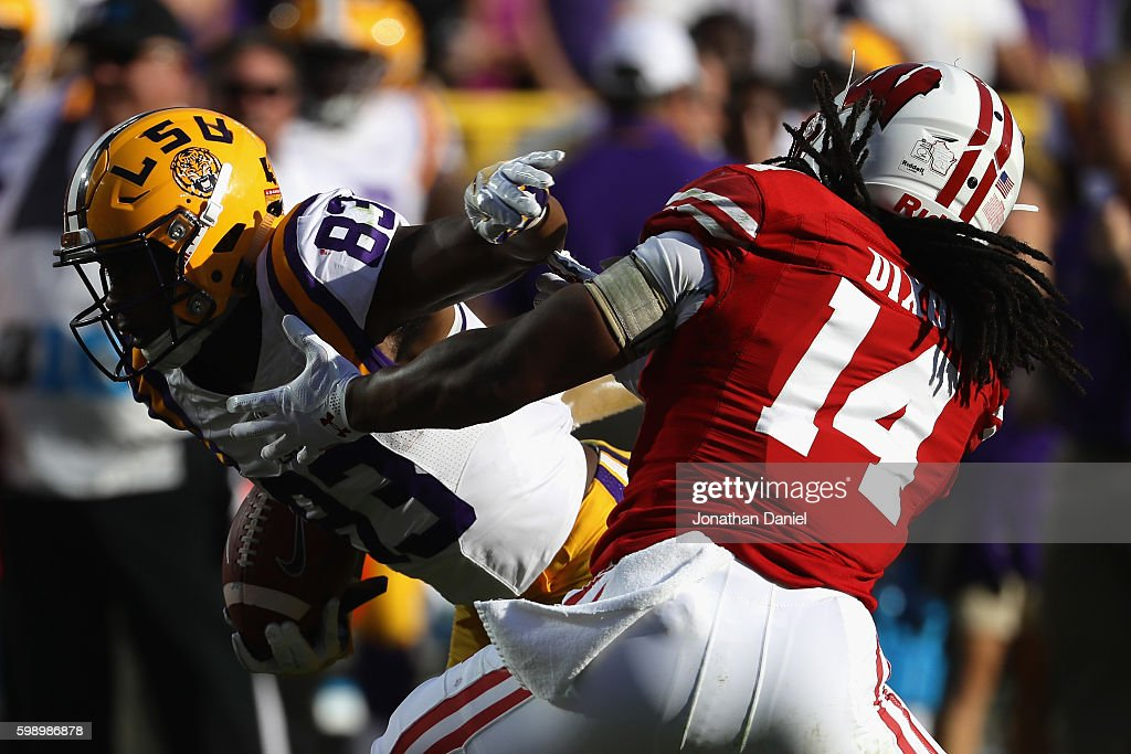 Travin Dural #83 of the LSU Tigers runs with the ball against D'Cota Dixon #14 of the Wisconsin Badgers on his way to scoring a touchdown after making a 10-yard reception during the third quarter at Lambeau Field on September 3, 2016 in Green Bay, Wisconsin.