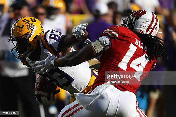 Travin Dural of the LSU Tigers runs with the ball against D'Cota Dixon of the Wisconsin Badgers on his way to scoring a touchdown after making a...
