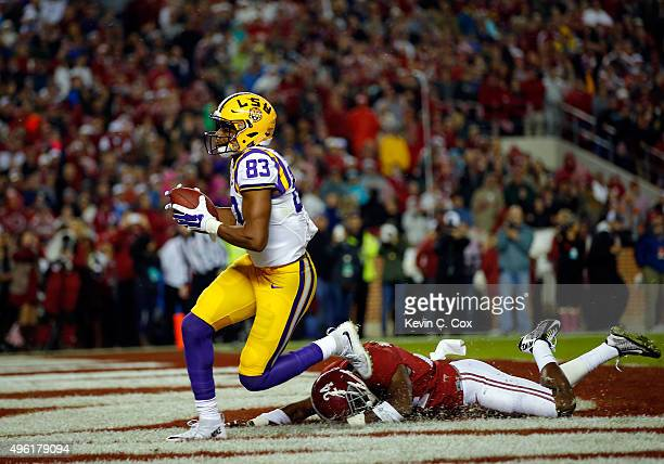 Travin Dural of the LSU Tigers scores with a touchdown reception against Geno Matias-Smith of the Alabama Crimson Tide in the second quarter at...