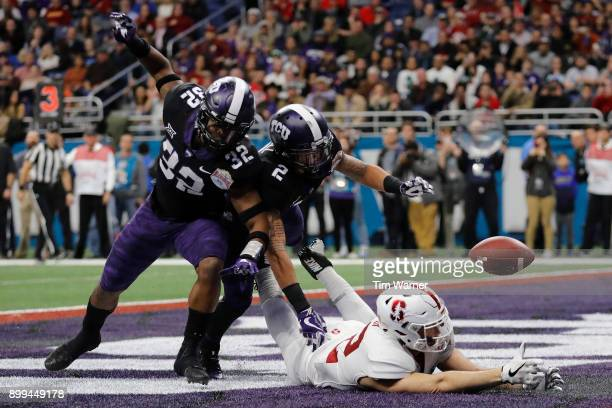Travin Howard of the TCU Horned Frogs and Niko Small break up a pass intended for Kaden Smith of the Stanford Cardinal in the third quarter during...