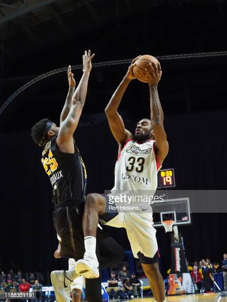 Travin Thibodeaux of the Fort Wayne Mad Ants shoots the ball against Vitto Brown of the Erie Bayhawks on December 13 2019 at Memorial Coliseum in...
