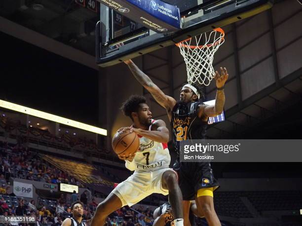 Travin Thidodeaux of the Fort Wayne Mad Ants battles EC Mattthews of the Erie Bayhawks on December 13 2019 at Memorial Coliseum in Fort Wayne Indiana...