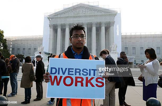 Travis Ballie holds a sign that reads in front of the US Supreme Court on October 10 2012 in Washington DC Today the high court is scheduled to hear...