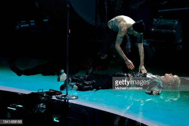 Travis Barker and Machine Gun Kelly perform onstage during the 2021 MTV Video Music Awards at Barclays Center on September 12, 2021 in the Brooklyn...