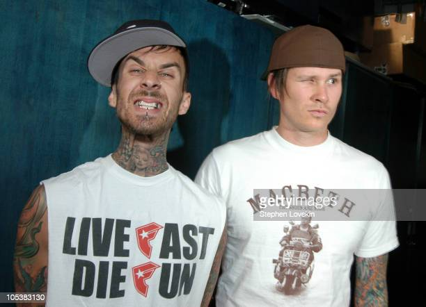 Travis Barker and Tom Delonge from Blink 182 during Blink 182 Omarion and Fabolous Visit MTV's TRL November 10 2004 at MTV Studios in New York City...