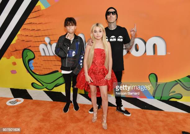 Travis Barker Landon Asher Barker and Alabama Luella Barker attend Nickelodeon's 2018 Kids' Choice Awards at The Forum on March 24 2018 in Inglewood...
