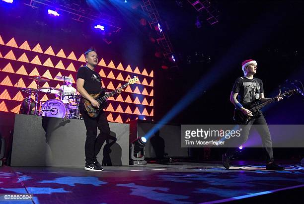 Travis Barker Mark Hoppus and Matt Skiba of Blink 182 perform during Live 105's Not So Silent Night at ORACLE Arena on December 9 2016 in Oakland...