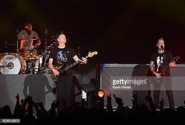 Travis Barker Mark Hoppus and Matt Skiba of the band Blink182 perform onstage at 1067 KROQ Almost Acoustic Christmas 2016 Night 1 at The Forum on...