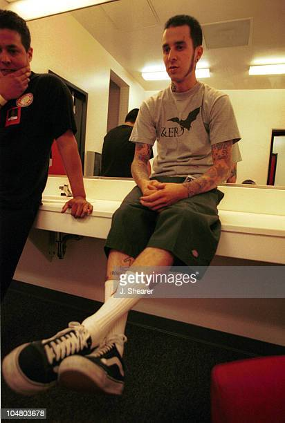 Travis Barker of Blink 182 backstage before their performance on New Years Eve.