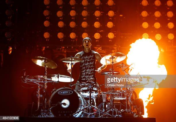 Travis Barker of Blink 182 performs on Day 3 of the Reading Festival at Richfield Avenue on August 24, 2014 in Reading, England.