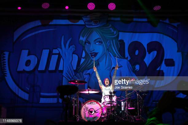"Travis Barker of the band Blink 182 performs at KROQ, Travis Barker & John ""Feldy"" Feldmann's Back To The Beach at Huntington State Beach on April..."