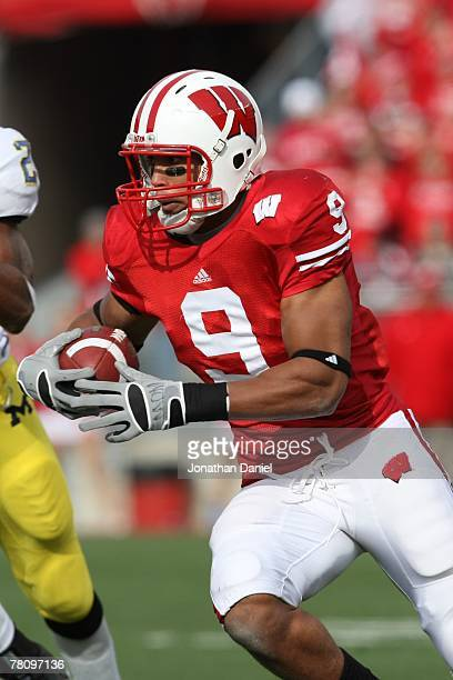Travis Beckum of the Wisconsin Badgers carries the ball during the game against the Michigan Wolverines at Camp Randall Stadium on November 10 2007...