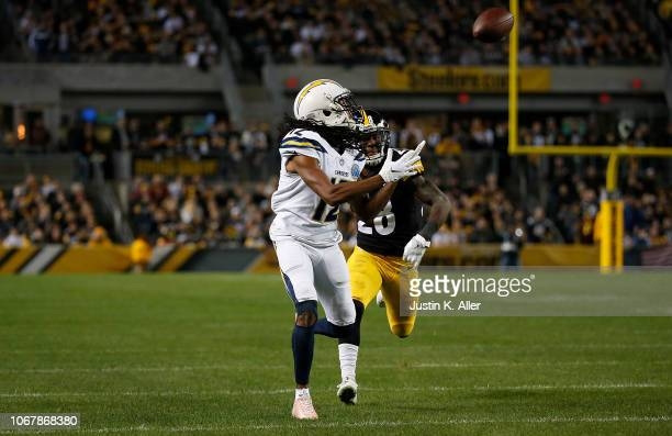 Travis Benjamin of the Los Angeles Chargers catches a pass for a 46 yard touchdown reception in the first quarter during the game against the...