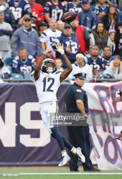 Travis Benjamin of the Los Angeles Chargers catches a touchdown pass during the fourth quarter of a game against the New England Patriots at Gillette...