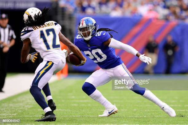 Travis Benjamin of the Los Angeles Chargers is knocked out of bounds by Janoris Jenkins of the New York Giants in the first quarter during an NFL...