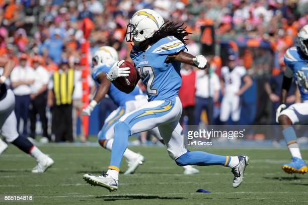 Travis Benjamin of the Los Angeles Chargers rushes en route to a 65yard punt return for a touchdown during the first quarter in the game against the...