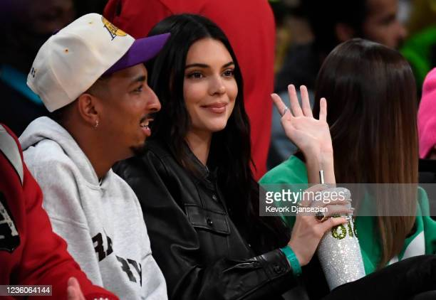 Travis Bennett, Kendall Jenner and Hailey Bieber attend the Phoenix Suns and Los Angeles Lakers baseball game at Staples Center on October 22, 2021...