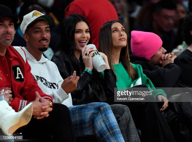 Travis Bennett, Kendall Jenner, Hailey Bieber and Justin Bieber attend the Phoenix Suns and Los Angeles Lakers baseball game at Staples Center on...