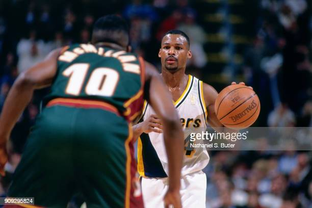 Travis Best of the Indiana Pacers dribbles during a game played on February 26 1997 at Market Square Arena in Indianapolis Indiana NOTE TO USER User...