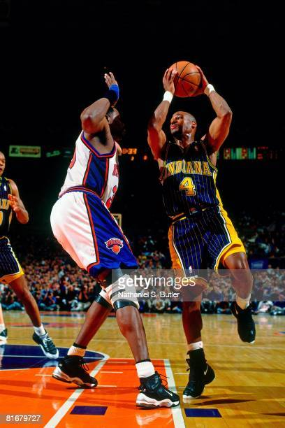 Travis Best of the Indiana Pacers goes up for a shot against Patrick Ewing of the New York Knicks in Game Four of the Eastern Conference Semifinals...