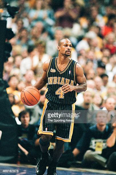 Travis Best of the Indiana Pacers moves the ball during Game One of the NBA Finals against the Los Angeles Lakers on June 7 2000 at Staples Center in...