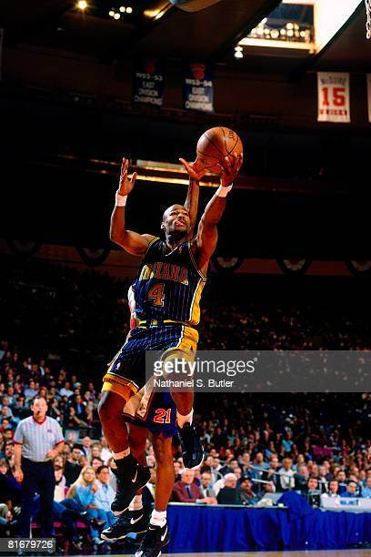 Travis Best of the Indiana Pacers shoots a layup against Charlie Ward of the New York Knicks in Game Four of the Eastern Conference Semifinals during...