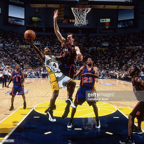 Travis Best of the Indiana Pacers shoots a layup against Chris Dudley of the New York Knicks in Game Two of the Eastern Conference Finals during the...