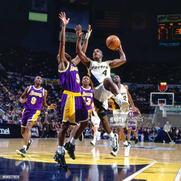 Travis Best of the Indiana Pacers shoots during a game played on March 2 1997 at Market Square Garden in Indianapolis Indiana NOTE TO USER User...