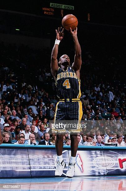 Travis Best of the Indiana Pacers shoots during the game against the Charlotte Hornets on April 9 2000 at Charlotte Colesium in Charlotte North...