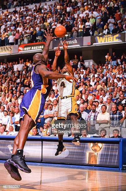 Travis Best of the Indiana Pacers takes a jump shot against Shaquille O'Neal of the Los Angeles Lakers during Game Four of the NBA Finals on June 14...