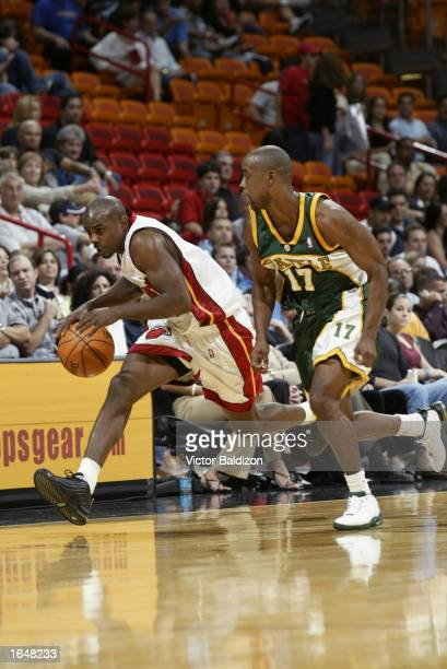 Travis Best of the Miami Heat moves the ball past Kenny Anderson of the Seattle Sonics during the NBA game at American Airlines Arena on November 9...