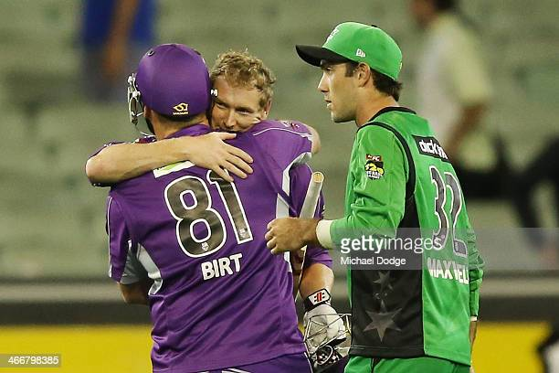 Travis Birt and George Bailey of the Hurricanes celebrate their win next to Glenn Maxwell of the stars during the Big Bash League Semi Final match...