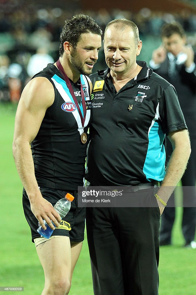 Travis Boak and Ken Hinkley of the Power speak after the the round six AFL match between Port Adelaide Power and the Geelong Cats at Adelaide Oval on April 27, 2014 in Adelaide, Australia.