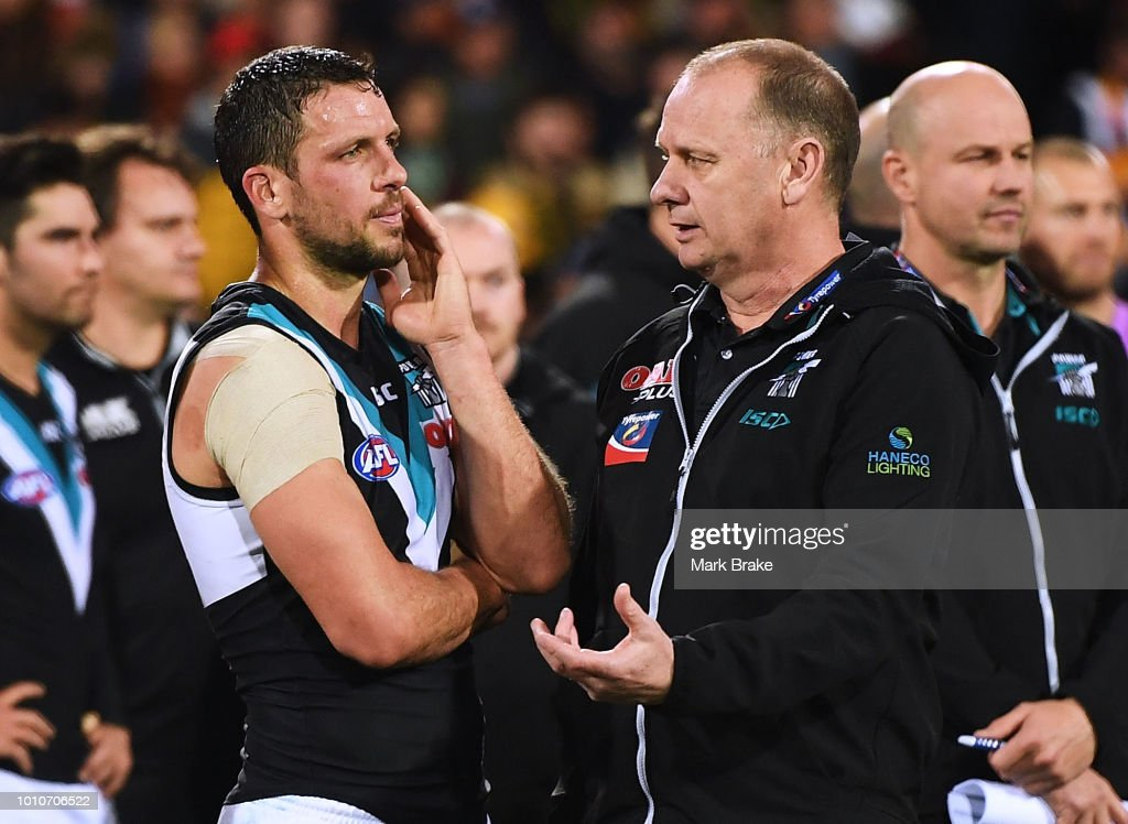 Travis Boak captain of Port Adelaide chats to Ken Hinkley Port Adelaide coach after the round 20 AFL match between the Adelaide Crows and the Port Adelaide Power at Adelaide Oval on August 4, 2018 in Adelaide, Australia.
