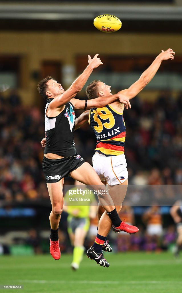 Travis Boak captain of Port Adelaide competes for the ball against Tom Doedee of the Adelaide Crows during the round eight AFL match between the Port Adelaide Power and the Adelaide Crows at Adelaide Oval on May 12, 2018 in Adelaide, Australia.