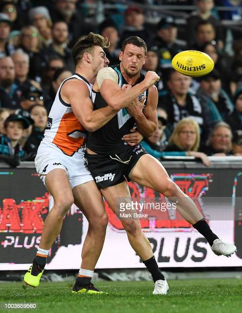 Lachie Whitfield of the Giants tackled by Lindsay Thomas of Port Adelaide during the round 18 AFL match between the Port Adelaide Power and the...