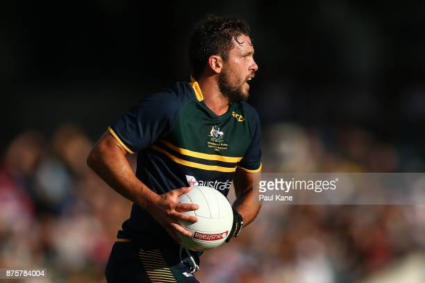 Travis Boak of Australia runs the ball during game two of the International Rules Series between Australia and Ireland at Domain Stadium on November...