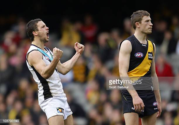 Travis Boak of the Power celebrates after kicking a goal during the round 22 AFL match between the Richmond Tigers and the Port Power at Etihad...