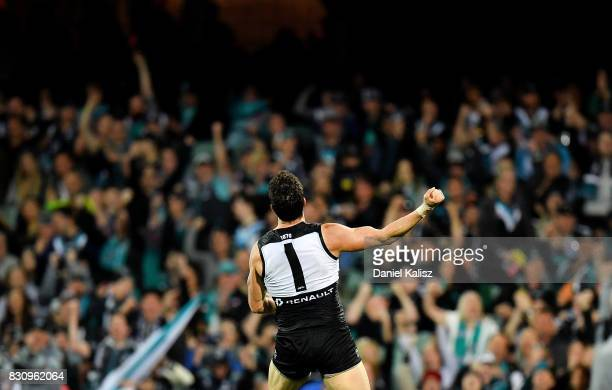 Travis Boak of the Power celebrates after kicking a goal during the round 21 AFL match between Port Adelaide Power and the Collingwood Magpies at...