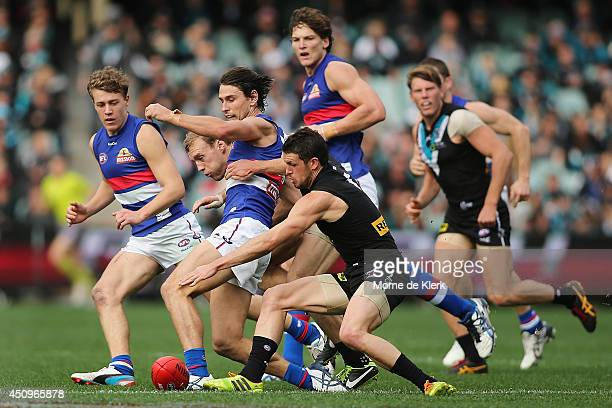 Travis Boak of the Power competes for the ball with Ryan Griffen of the Bulldogs during the round 14 AFL match between the Port Adelaide Power and...