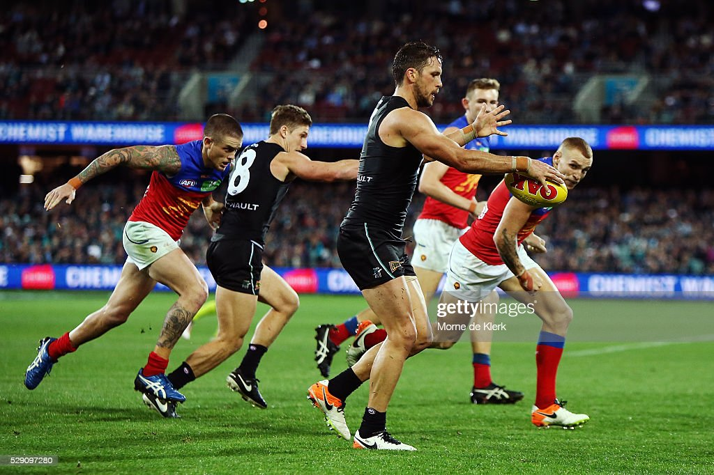 Travis Boak of the Power kicks the ball during the round seven AFL match between the Port Adelaide Power and the Brisbane Lions at Adelaide Oval on May 8, 2016 in Adelaide, Australia.