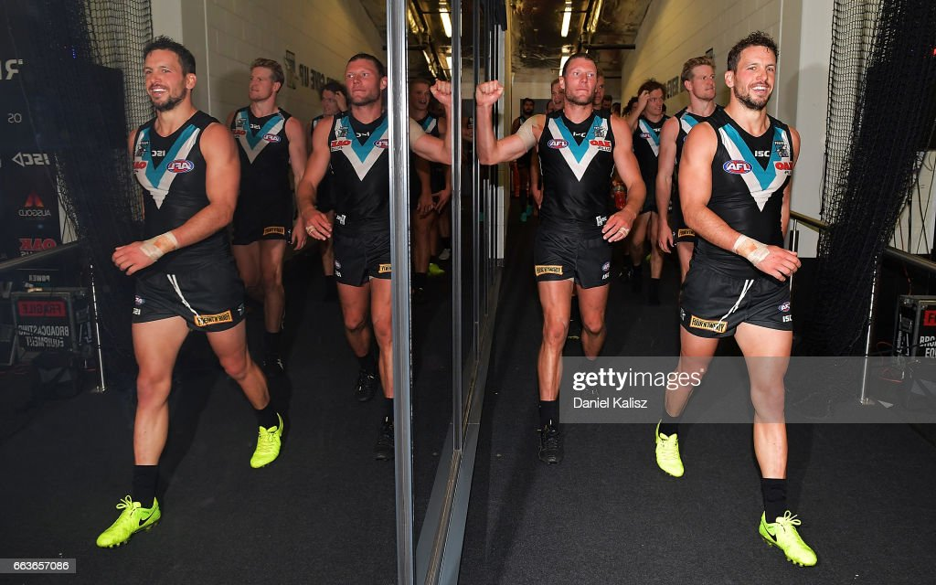 Travis Boak of the Power leads his players from the field after the round two AFL match between the Port Adelaide Power and the Fremantle Dockers at Adelaide Oval on April 2, 2017 in Adelaide, Australia.