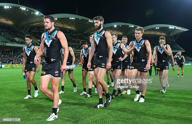Travis Boak of the Power leads the players off after their defeat during the round two AFL match between the Port Adelaide Power and the Sydney Swans...