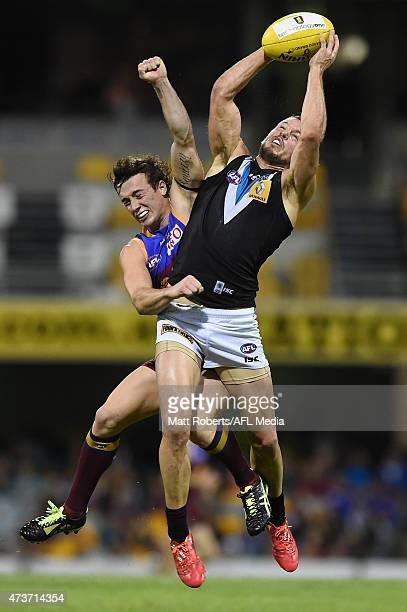 Travis Boak of the Power marks the ball over Lewis Taylor of the Lions during the round seven AFL match between the Brisbane Lions and the Port...