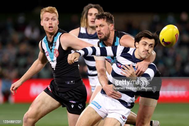 Travis Boak of the Power tackles Brad Close of the Cats during the 2021 AFL Round 23 match between the Adelaide Crows and the North Melbourne...