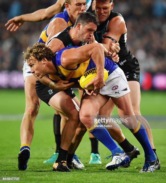 Travis Boak of the Power tackles Matt Priddis of the Eagles during the AFL First Elimination Final match between Port Adelaide Power and West Coast...