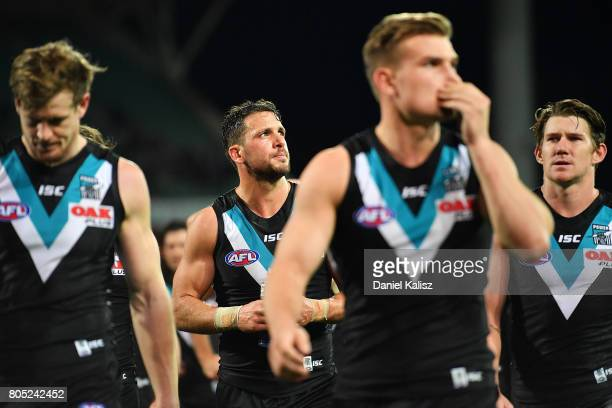 Travis Boak of the Power walks from the field looking dejected during the round 15 AFL match between the Port Adelaide Power and the Richmond Tigers...