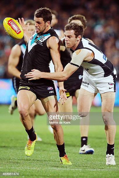 Travis Boak of the Power wins the ball in front of Sam Docherty of the Blues during the round 22 AFL match between the Port Adelaide Power and the...