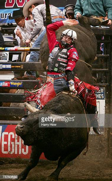 Travis Briscoe attempts to ride a bull during the final of the PBR Amp'd Mobile Invitational in the 2007 Professional Bull Riders Built Ford Tough...